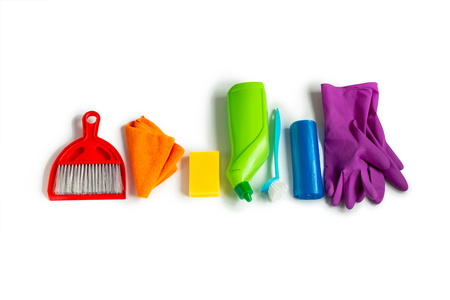 Cleaning products set of rainbow colors isolated on white background. Spring cleaning concept. Top view