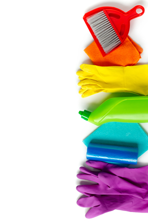 Cleaning products set of rainbow colors isolated on white background. Spring cleaning concept. Top view, copy space. Archivio Fotografico