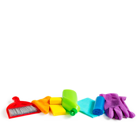 Colorful cleaning set for different surfaces in kitchen, bathroom and other rooms. Copy space. Cleaning service concept. Stock Photo