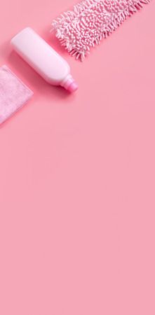 MOP, rag and detergent-pink set on pink background for spring cleaning. Copy space. Stock Photo