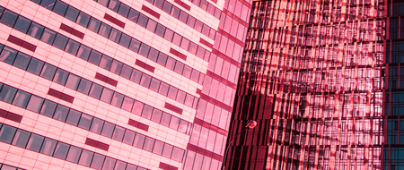 View of modern skyscrapers  - abstract architecture detail in blue and living coral colors. Banque d'images