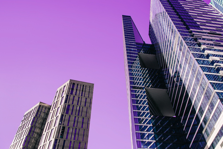 Futuristic landscape of silhouettes of skyscrapers in the city. Toned image.