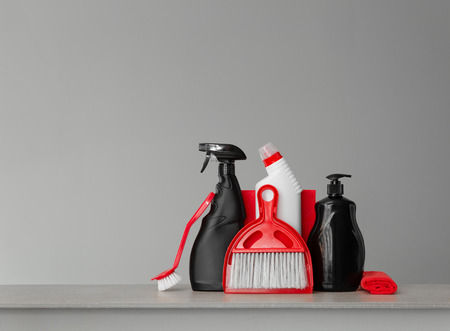 Red and black cleaning kit - scoop and broom, cloths, brush, toilet detergent, dishwashing liquid and spray for glass.