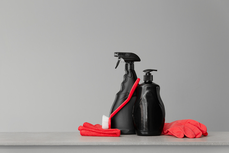 Red and black set of tools and tools for cleaning the kitchen. Neutral background.Copy space.