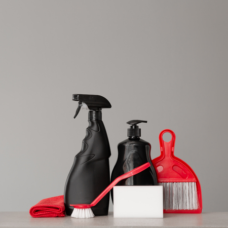 Cleaning kit on neutral background. Place for text.