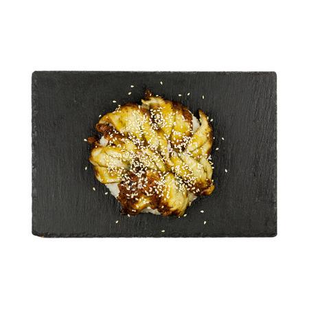 Japanese cuisine - Unagi - smoked conger on rice with sesame. Reklamní fotografie