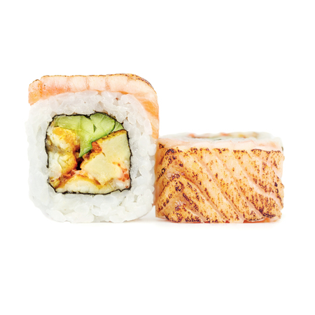Traditional fresh japanese sushi rolls isolated on a white background. Rice, cucumber, congereel, omelet and smoked salmon. Reklamní fotografie