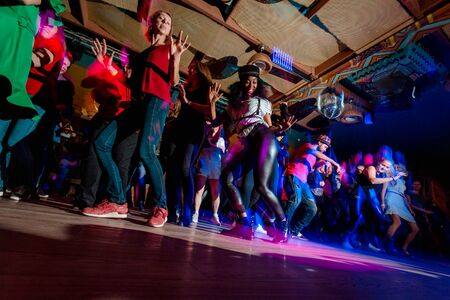 MOSCOW, RUSSIAN FEDERATION - OCTOBER 13, 2018: Cuban dance teachers conduct a master class in salsa and reggaeton in the night club Tiki bar.