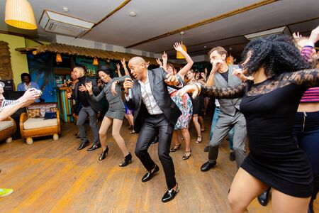 Moscow, Russia-January 19, 2019: Cuban dance teachers conduct a master class in salsa and reggaeton in the night club Tiki bar. Editorial