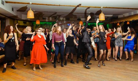 Moscow, Russia-January 19, 2019: people of different races dance in the club and broadcast the party Editorial