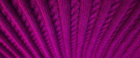 Suaves pliegues de lana a cuadros. Fondo tejido con textura