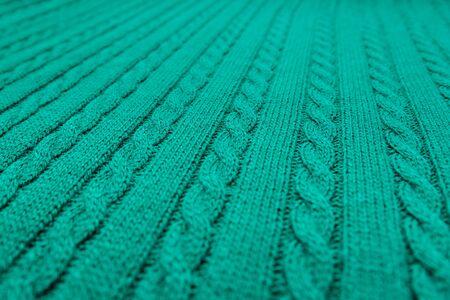Coleta tejida a cuadros azul. Textura de lana para el fondo. Enfoque suave.