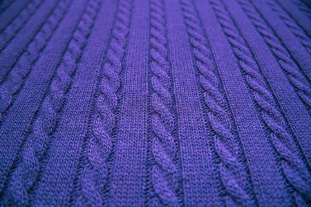 Knitted blanket. Soft and warm fabric. Texture for background or illustrations.