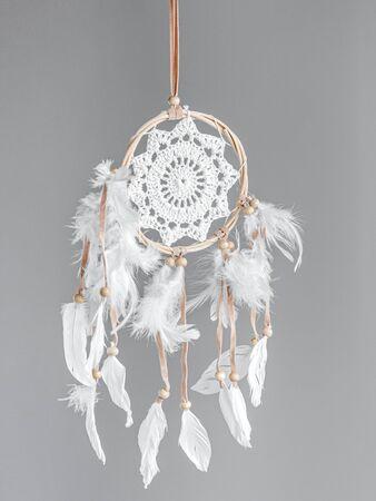 White dreamcatcher at gray background. Interior decoration. Native American Dreamcatcher Foto de archivo