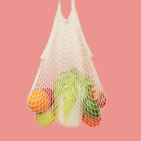 String bag full of vegetables and fruits. Eco habits. Reusable bag, shopping without plastic packaging.