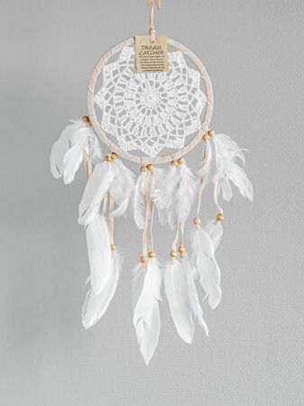 White dreamcatcher - Indian amulet that protects the sleeper from evil spirits and diseases. Card with instructions.