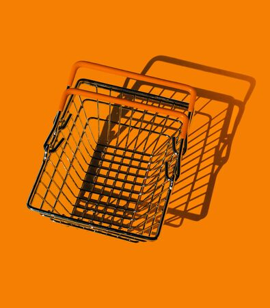 An empty metal shopping basket from a supermarket. A symbol of reduced consumption during the epidemic of coronavirus. The view from the top