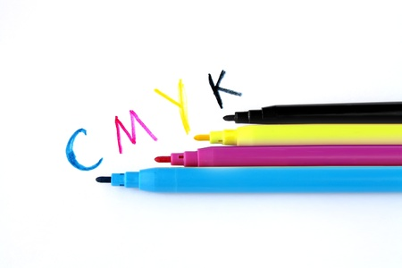 cmyk soft tip pens with sign on white background photo