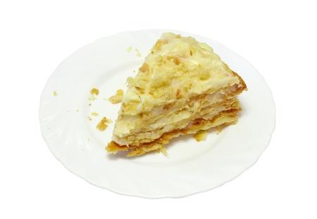 Pie Napoleon on white plate on white table cloth