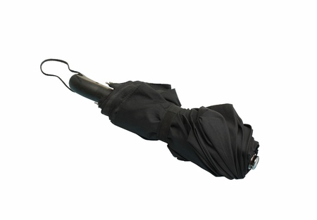 black automatic umbrella closed isolated on a white background photo
