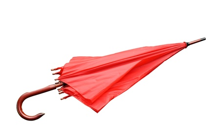 red umbrella closed isolated on a white background photo