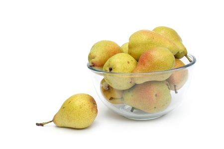 yellow pears on glass dish isolated on a white photo