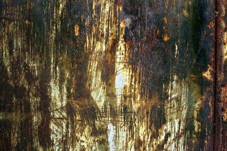 metal corrosion: rusty grange texture wall with burnt and torn paper