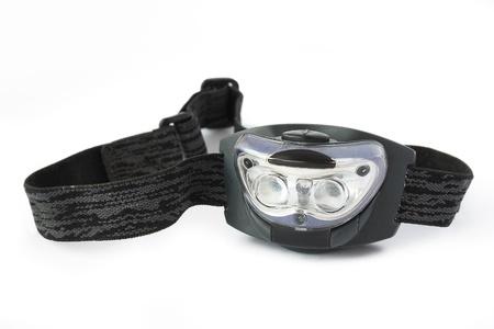 head flashlight with ribbon on a white photo