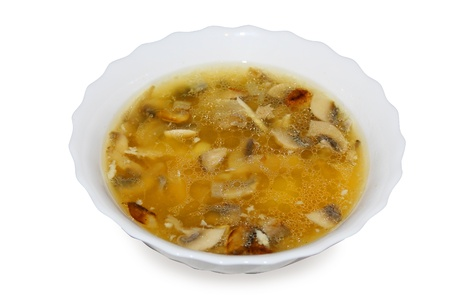 chicken mushroom soup in the plate over white photo