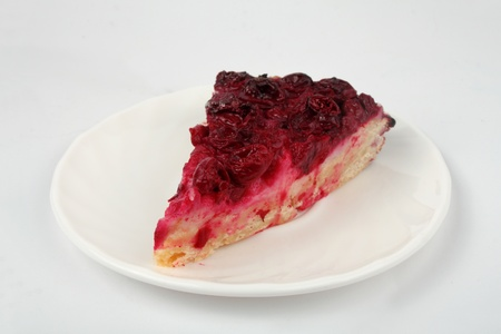 cherry open pie on the plate isolated over white photo