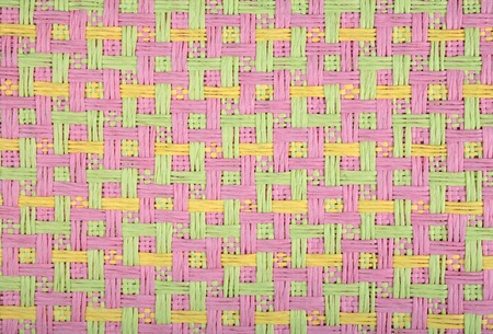 rug textured fabric in three colors green, yellow and pink, used for interiors as wallpaper photo