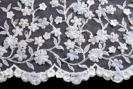 luxury wedding lace with pearls isolated on black background photo