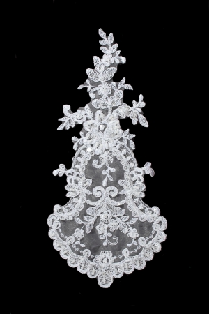 luxury wedding lace with pearls isolated on black background