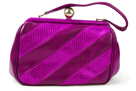 old magenta purse isolated over white background photo