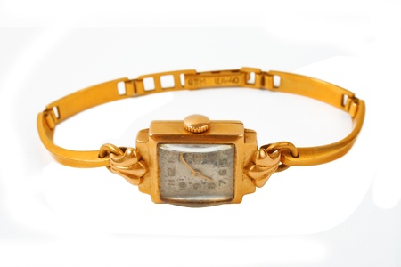 preasure: woman golden watch very old isolated over white background
