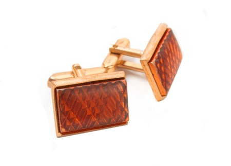 Pair of old retro cufflinks in closeup on a white background photo