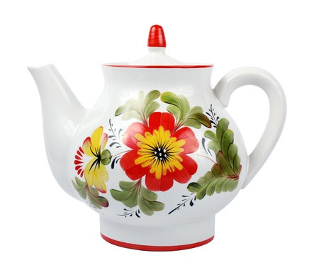 olf fashioned porcelain teapot isolated over white photo