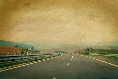 winding road: windy road picture aged and damaged in retro style Stock Photo