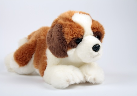 little puppy toy with brown spots photo