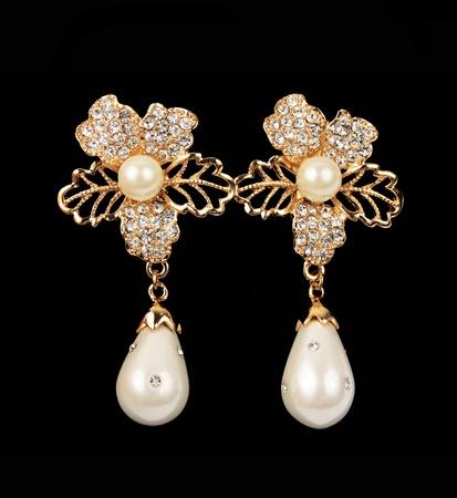 pearl earrings flower shape over black background Stock Photo - 12121270