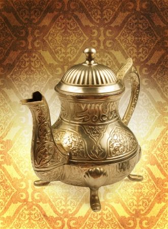 arabic teapot on concept golden damas background photo