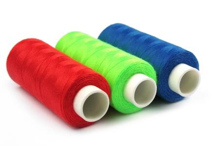 thre thread spools red green blue, RGB colors