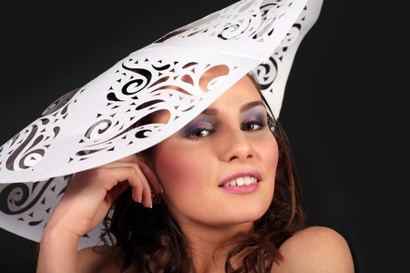 fashion girl in paper dress and hat over black background Stock Photo - 13013425