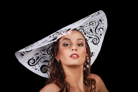 Gorgeous glamour woman close up in big white paper hat isolated over black background Stock Photo - 13013405