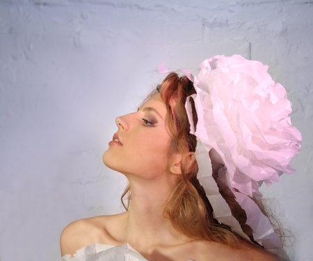Beautiful Fashion Young Woman in Pink Paper headdress, Red hair photo