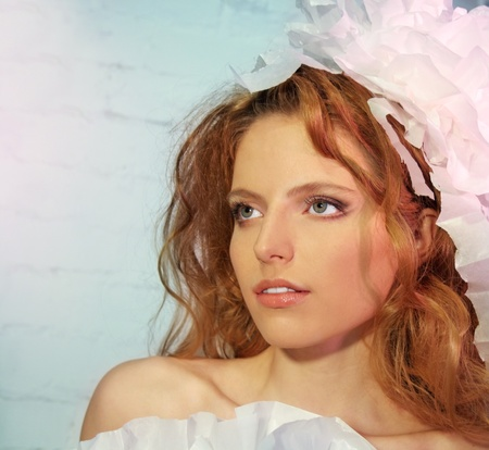 Beautiful Fashion Young Woman in Paper headdress, Red Hair photo