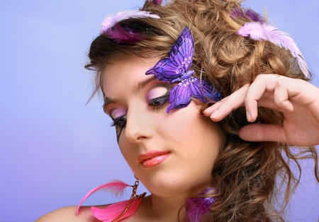 eyeshades: Young beauty girl with perfect butterfly make up and hairstyle