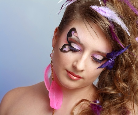 Young model beautyful women with perfect butterfly make up and hairstyle clouse-up Stock Photo - 13401353