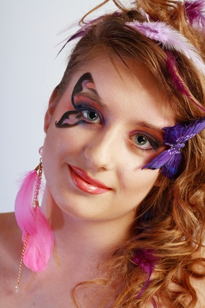 eyeshades: Young model beautyful women with nice smile with perfect butterfly make up and hairstyle clouse-up Stock Photo