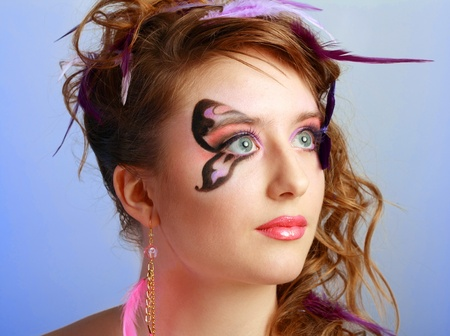 Young model beautyful women with perfect butterfly make up and hairstyle clouse-up Stock Photo - 13401392